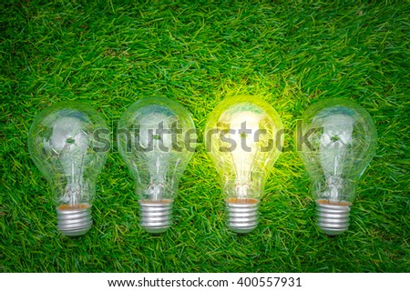 Eco concept - light bulb grow in the grass - stock photo