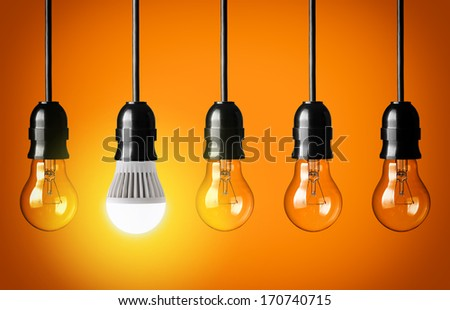 Eco concept with glowing LED bulb - stock photo