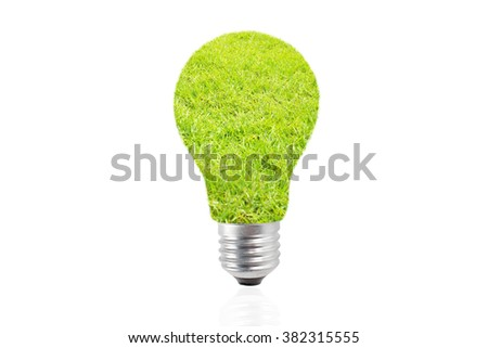 Eco energy bulb in grass - stock photo