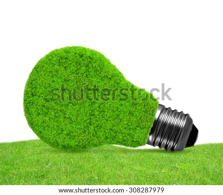 Eco energy bulb in grass - green energy concept - stock photo