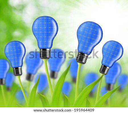 eco energy bulbs from solar panels - stock photo