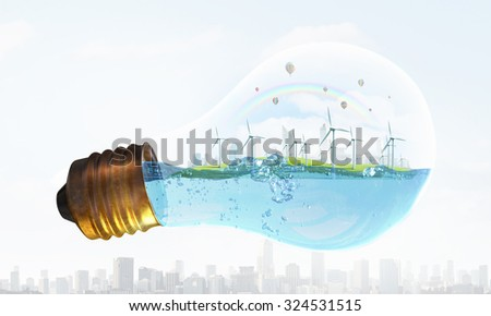 Eco energy concept with windmills inside of light bulb  - stock photo