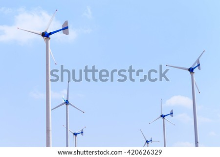 Eco energy - wind turbines are working in power station with blue sky background - stock photo