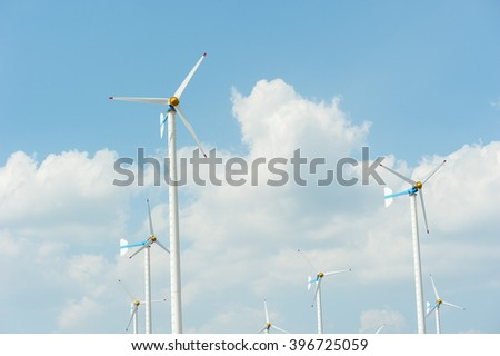 Eco energy - wind turbines ,blue sky background