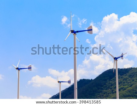 Eco energy - wind turbines in power station with blue sky background - stock photo