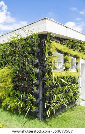 Eco-friendly green architecture features plants growing on the walls under a bright blue sunny sky in Rio de Janeiro, Brazil - stock photo