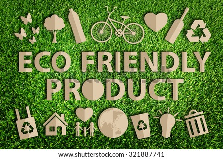 Eco friendly product word. Paper cut of eco on green grass. - stock photo