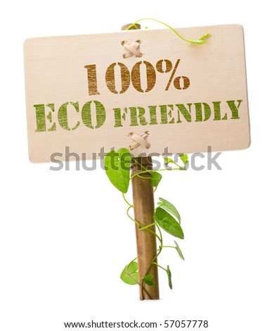 eco friendly sign message on a wooden panel and green plant - image is isolated on a white background - stock photo