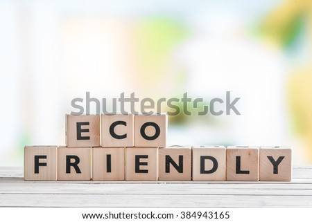 Eco friendly sign on a wooden table in nature