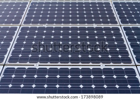 Eco-friendly solar panels photographed in color on a country property for energy generation and sustainable electricity production.