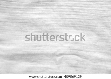 eco friendly washeable textile diapers - white textile background - stock photo