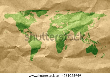 Eco green energy world continents map on wrinkled paper - stock photo