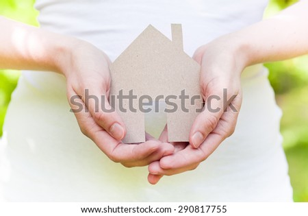 eco haous in hands - stock photo