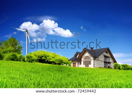 Eco House on a green hill - stock photo