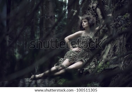 Eco lady lying on the trunk - stock photo