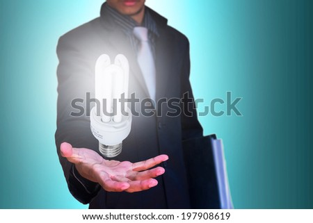 eco lamp in hand businessman