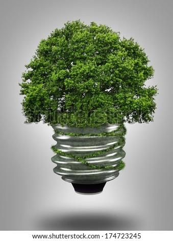eco light bulb and tree - stock photo