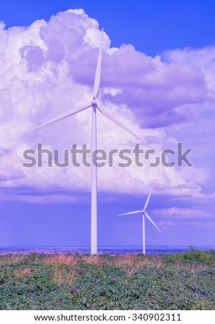 Eco power, Wind turbine electric generator with blue sky in Huai Bong district, Thailand  - stock photo