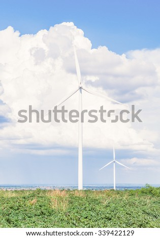 Eco power, Wind turbine electric generator with blue sky in Huai Bong district, Thailand ,eco power, wind turbines  - stock photo