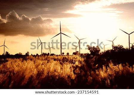 Eco power ,wind turbine power generator at twilight - stock photo