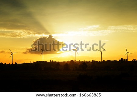 Eco power, wind turbines at sunset