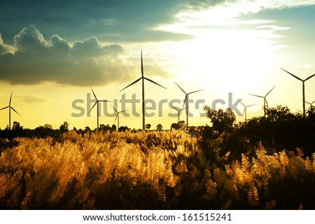 Eco power, wind turbines at sunset - stock photo