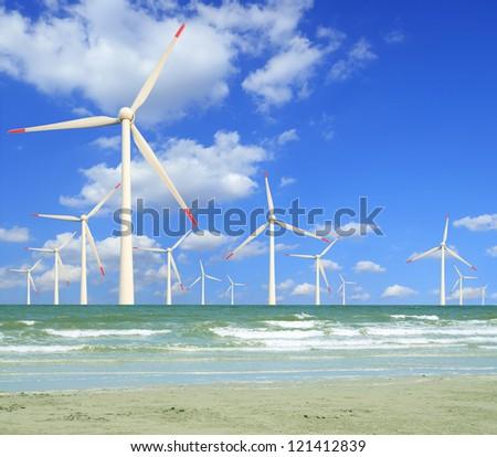 Eco power, wind turbines in the sea - stock photo