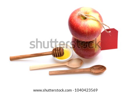 Eco shopping and autumn crops concept. Composition of apples and rustic cutlery. Apples and honey isolated on white background, copy space. Set of fruit, wooden spoons and empty red price tag.