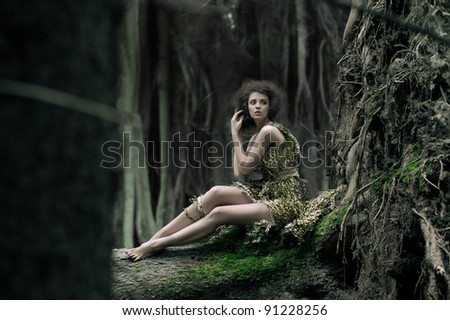Eco woman sitting on the trunk - stock photo