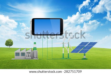 Ecofriendly concept.  Green factory, wind turbine and solar panel connected to smartphone on green lawn with tree. - stock photo