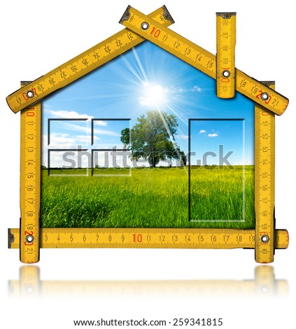 Ecologic House Project Concept. Wooden yellow meter ruler in the shape of house with country landscape with tree inside. Isolated on white background - stock photo