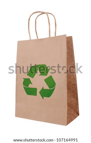Ecological brown paper bag with recycling symbol - stock photo