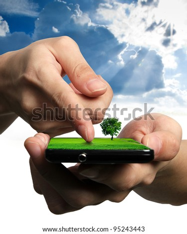 Ecological Concept, touch screen mobile phone - stock photo
