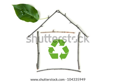 Ecological house made up of branches and green leaf with recycling logo in the center - stock photo