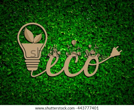 Ecology and environmentally friendly planet concept. Green house and solar panels on paper cut die- cut from cardboard.on grass blurred background.Think Green and  Eco design - Green and Sustainable. - stock photo