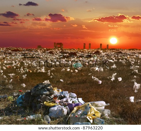 Ecology concept about mud and human activity - junk yard and garbage. Environmental pollution from industrial destruction at the city. - stock photo