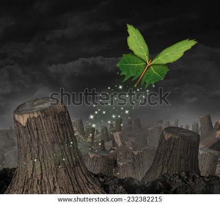 Ecology concept and new beginning symbol as a group of green leaves shaped as a butterfly flying up away from a forest of chopped trees as an icon for success and persistence for the future. - stock photo