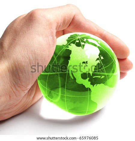 ecology concept with hand and glass globe isolated on white background - stock photo