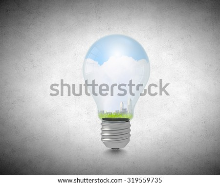 Ecology concept with light bulb and city inside