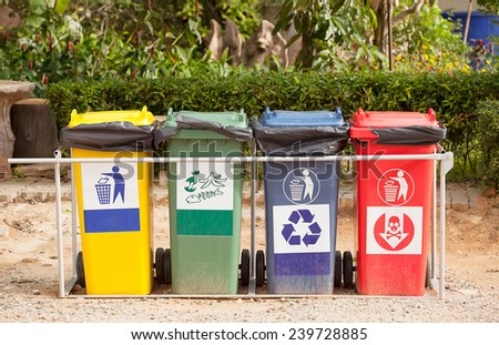 Ecology container recycling bins in the park. - stock photo
