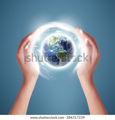 Ecology Earth Concept - Protectors of the Earth (Elements of this image furnished by NASA)