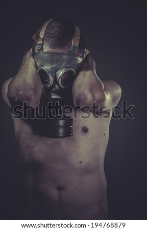 Ecology, Nude man with gas mask, pollution concept