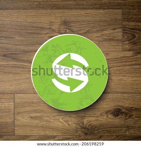 Ecology sign on wooden background - stock photo