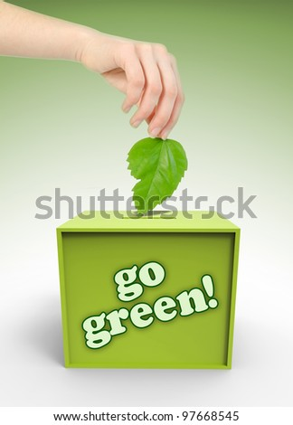 Ecology voting box with hand and leaf on green background - stock photo