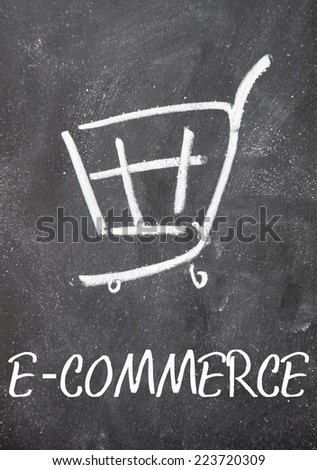 ecommerce word and shopping cart sign on blackboard - stock photo