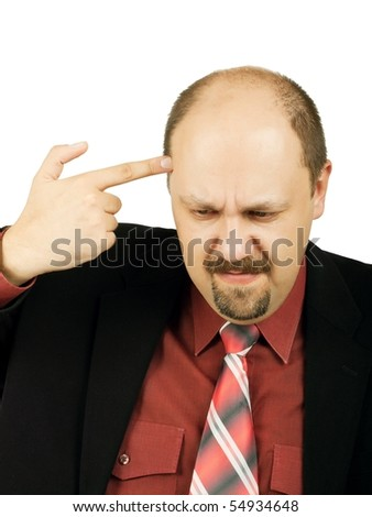 Economic depression. Businessman pointing his handgun to his head - stock photo