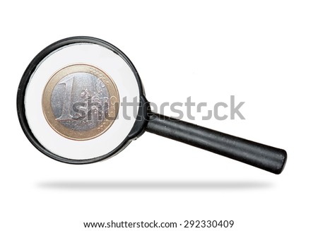 Economic speculation etc. Euro coin under magnifying glass. - stock photo