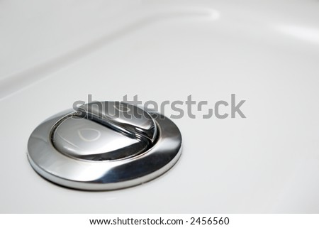 economic toilet flush knob with two separate buttons - stock photo