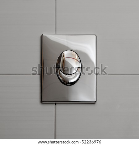 Economic toilet flush knob with two separate buttons. Grey tiles background - stock photo