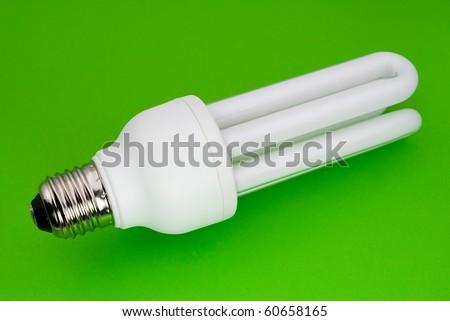 economical lamp green background - stock photo